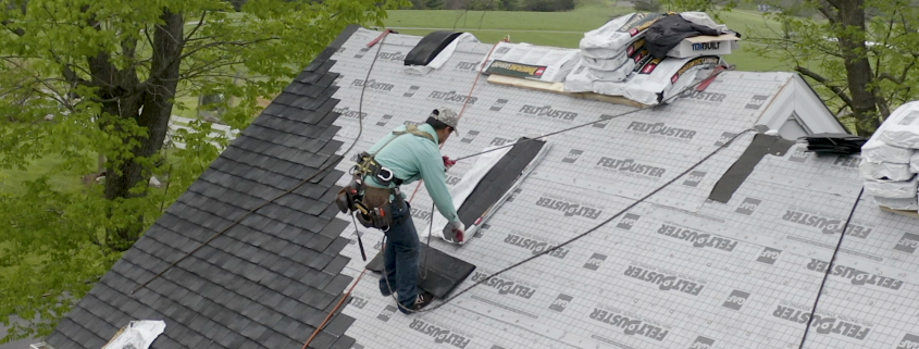 roofer puts shingles on house in the Shenandoah Valley
