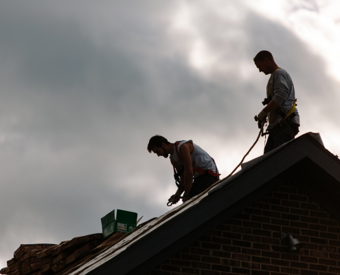 workers installing roof