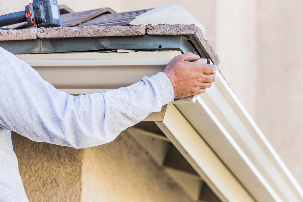 worker installing gutters