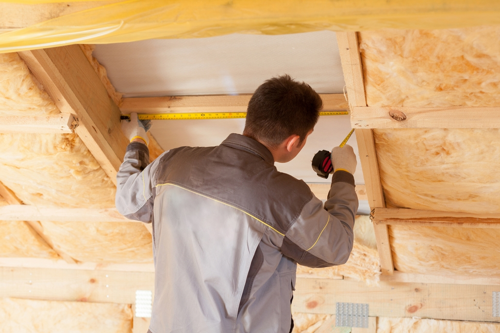 Back View Of Roofer Builder Worker With Ruler measuring