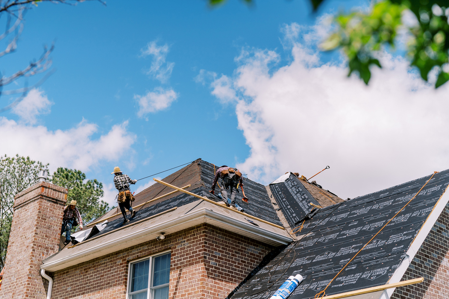 Valley Roofing & Exteriors roofers working